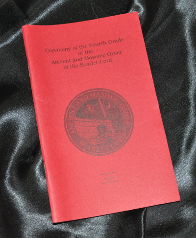 43ab446dcc06 Tie - Order of Secret Monitor · Scarlet Cord - 4th Grade Ritual Book